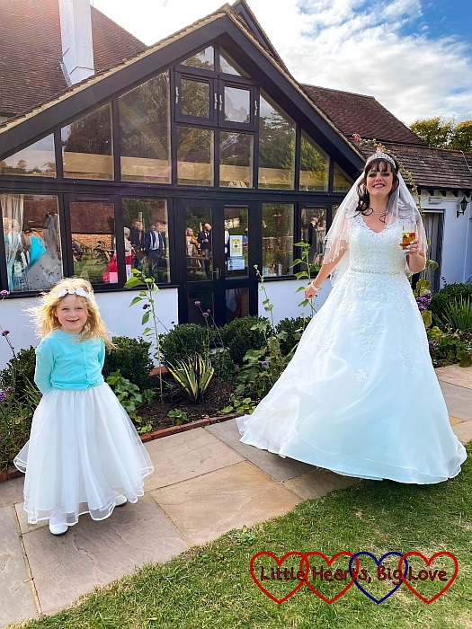 Sophie and my sister standing a little apart at my sister's wedding