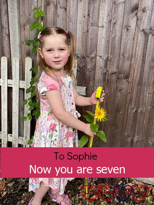 """Sophie measuring a sunflower in the garden - """"To Sophie - now you are seven"""""""
