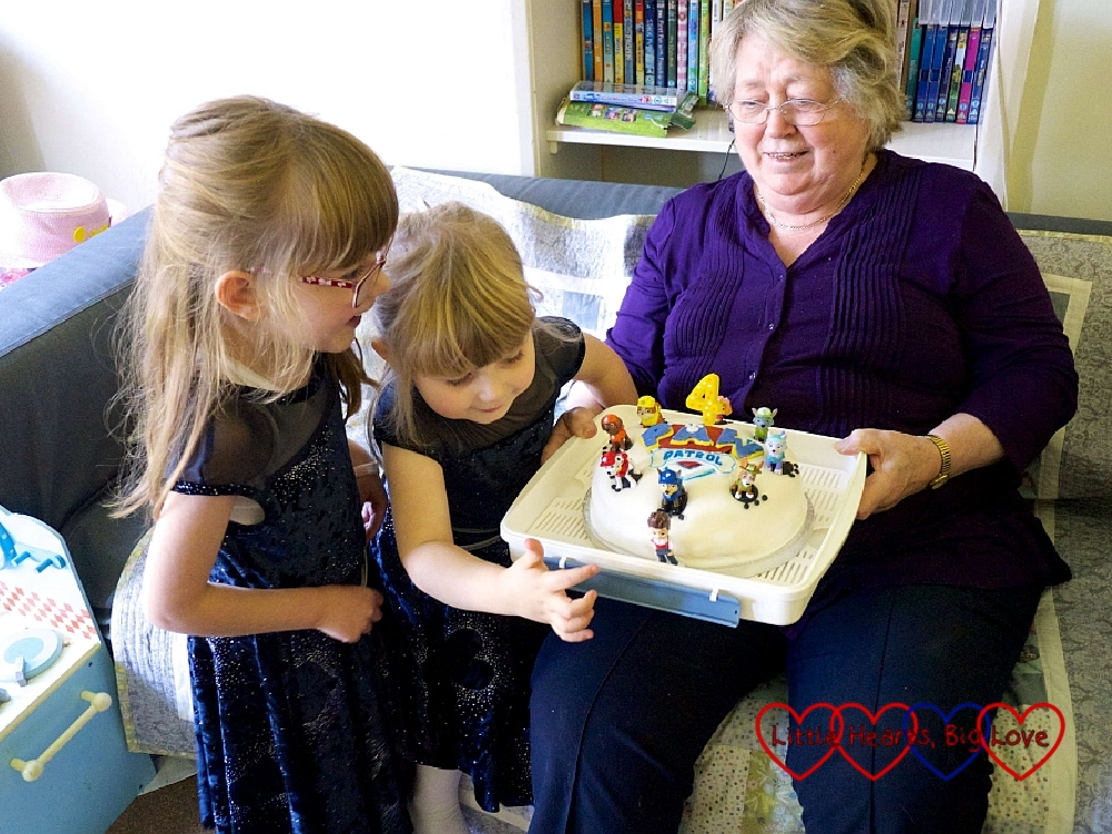 Jessica and Sophie with Grandma holding Sophie's 4th birthday cake (a PAW Patrol cake)