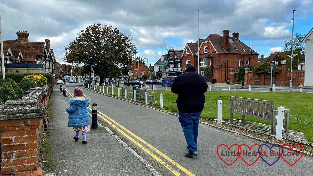 Sophie and Daddy walking along the main road in Datchet