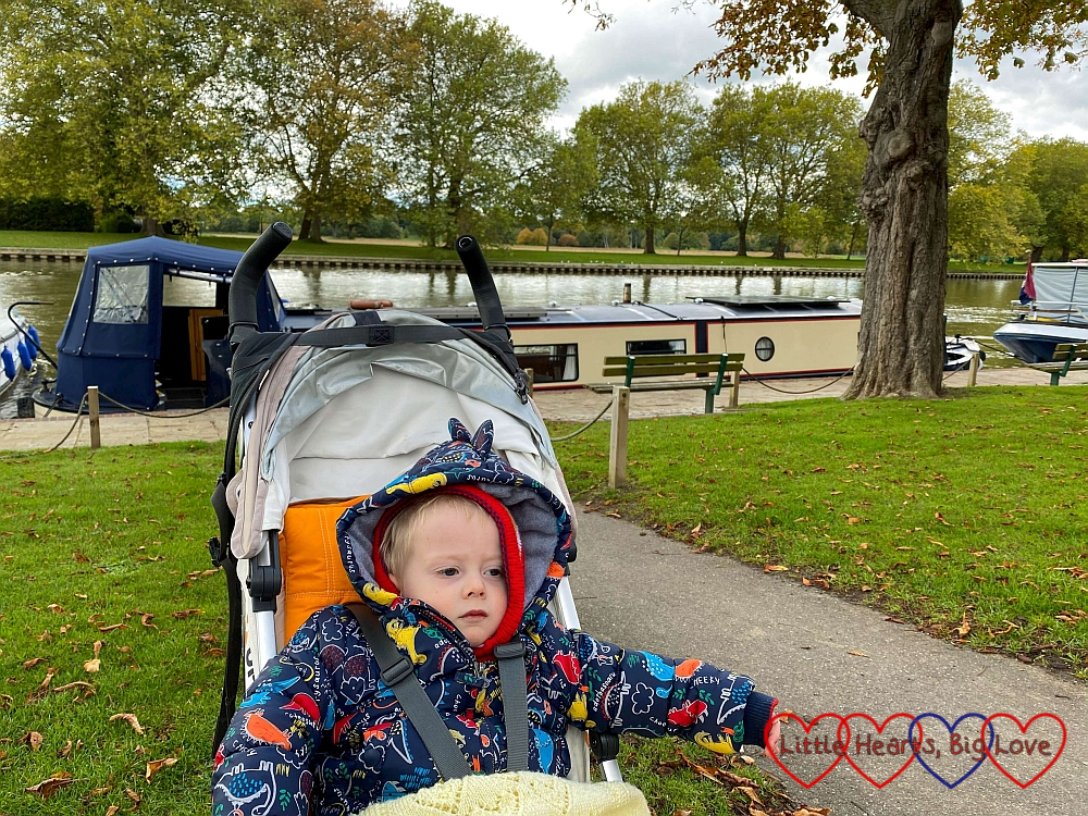 Thomas in his buggy with the River Thames and narrowboats in the background