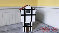 A model of a 1666 house made from cardboard boxes and craft sticks