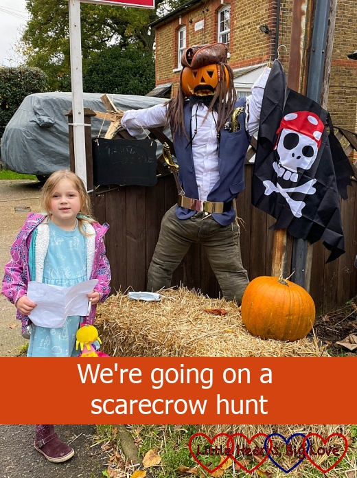 "Sophie with a scarecrow dressed as a pirate captain - ""We're going on a scarecrow hunt"""