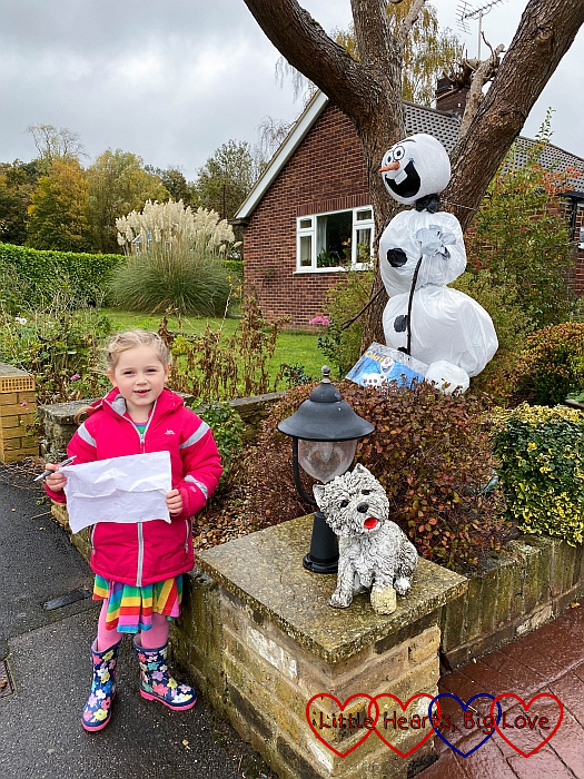 Sophie with an Olaf-themed scarecrow
