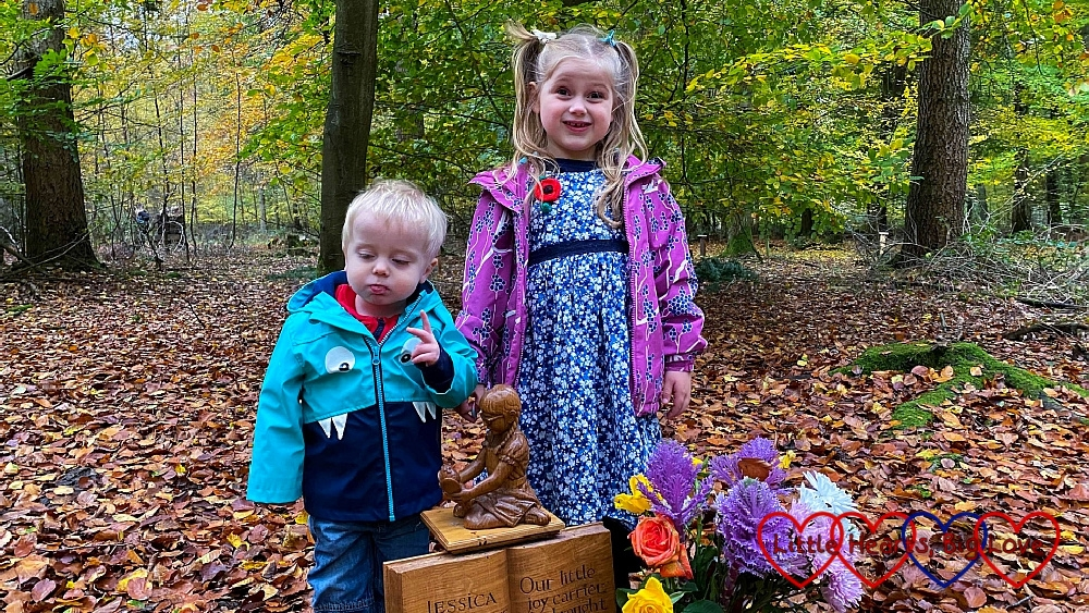 Sophie and Thomas with the carving of Jessica at Jessica's forever bed
