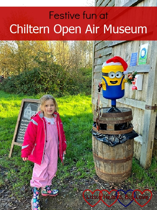 "Sophie standing outside the Northolt Barn at Chiltern Open Air Museum, next to a Minion wearing a Santa hat - ""Festive fun at Chiltern Open Air Museum"""