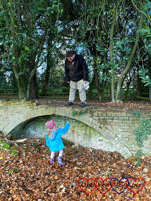 Sophie standing on the group with Daddy standing on a 'bridge' above her