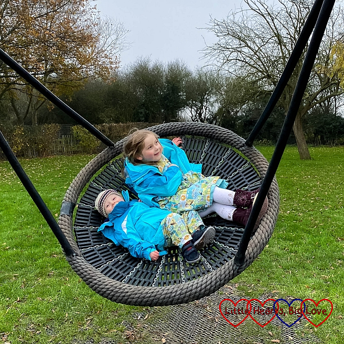 Thomas and Sophie on a spider swing at the park