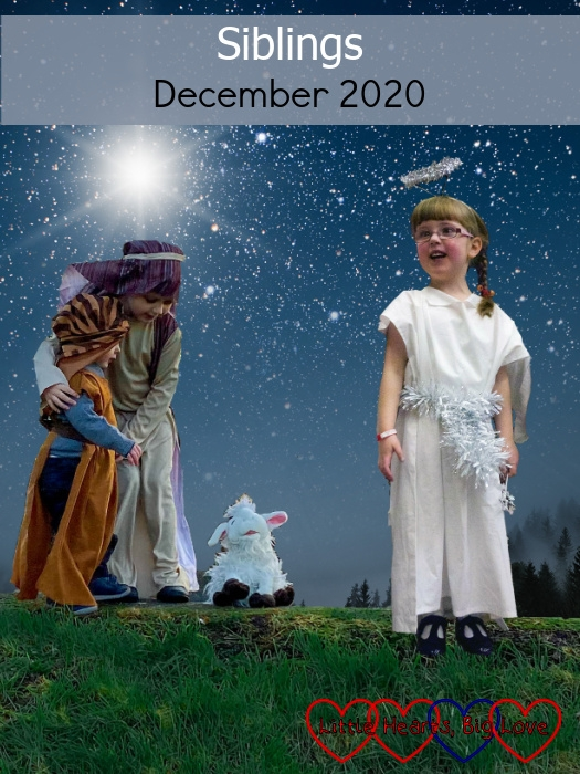 "Sophie and Thomas dressed as shepherds with Sophie hugging Thomas and looking down at her toy goat and Jessica dressed as an angel standing next to them against a starry sky background - ""Siblings - December 2020"""