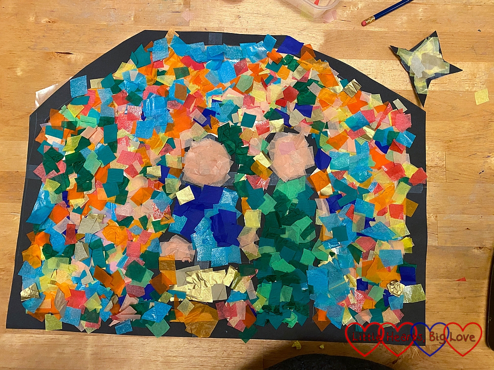 The finished Nativity scene filled in with pieces of coloured tissue paper