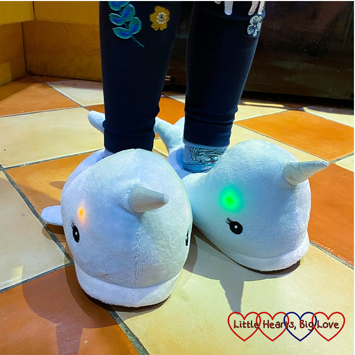 Sophie's new light-up narwhal slippers