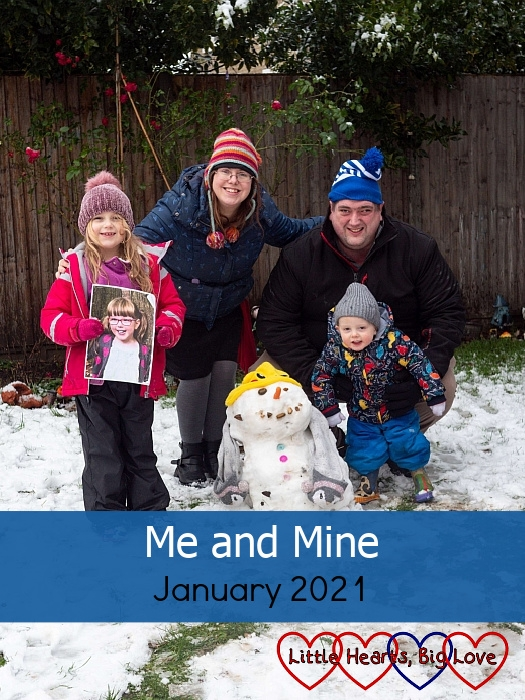 "Sophie (holding a photo of Jessica), me, hubby and Thomas out in the garden in the snow with Sophie's snowman in front of us - ""Me and Mine - January 2021"""