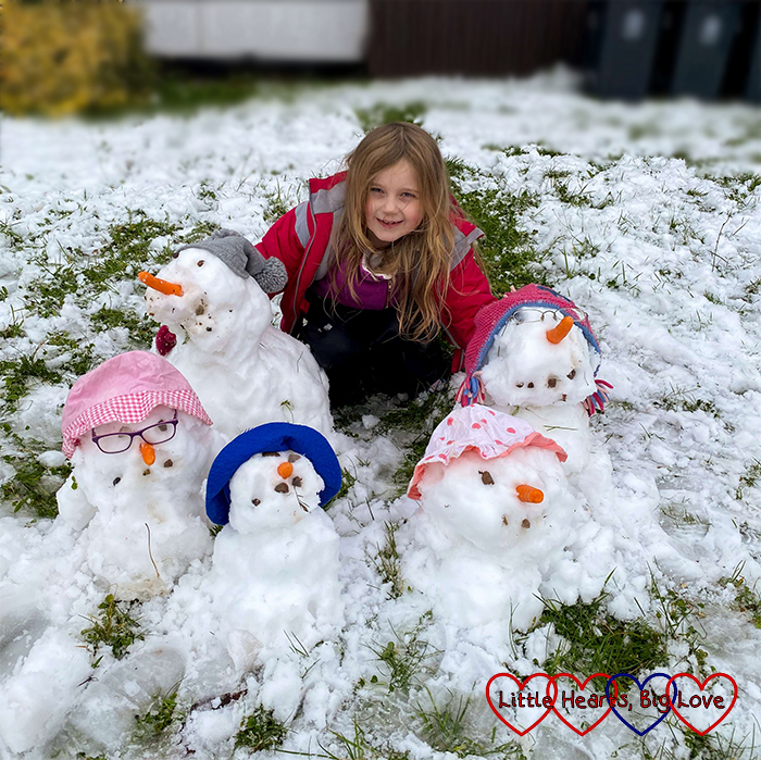 Sophie with her snow family