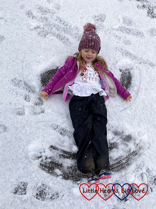 Sophie making a snow angel