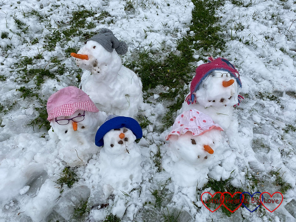 A family of five snowmen