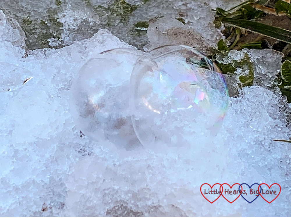 A frozen bubble popping in the snow