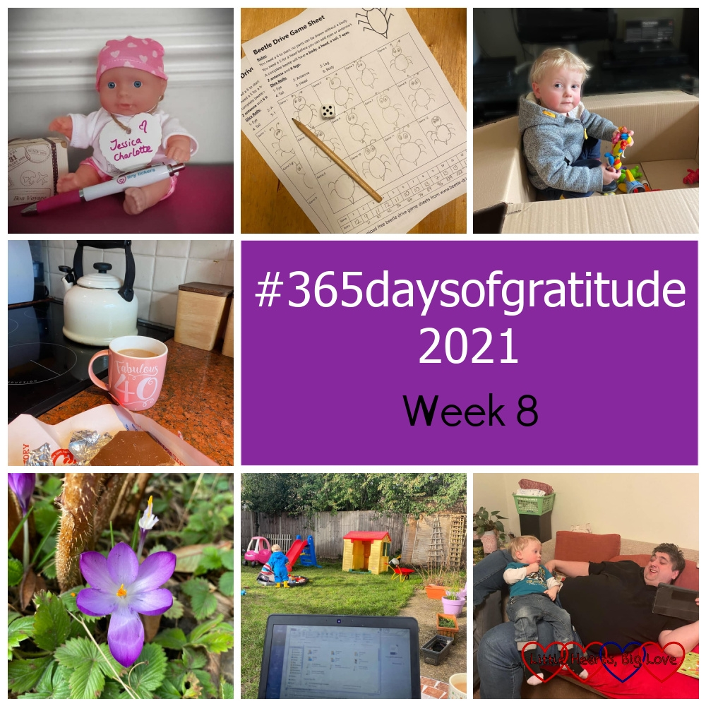 """A Tiny Ticker situs doll with a name tag saying """"Jessica Charlotte""""; a beetle drive game sheet; Thomas sitting in a cardboard box with toys; a cup of tea and a bar of chocolate; a purple crocus; the top of my laptop in the foreground with Sophie and Thomas playing in the garden in the background; Thomas sitting on Daddy's lap as they both relax on the sofa - """"#365daysofgratitude 2021 - Week 8"""""""