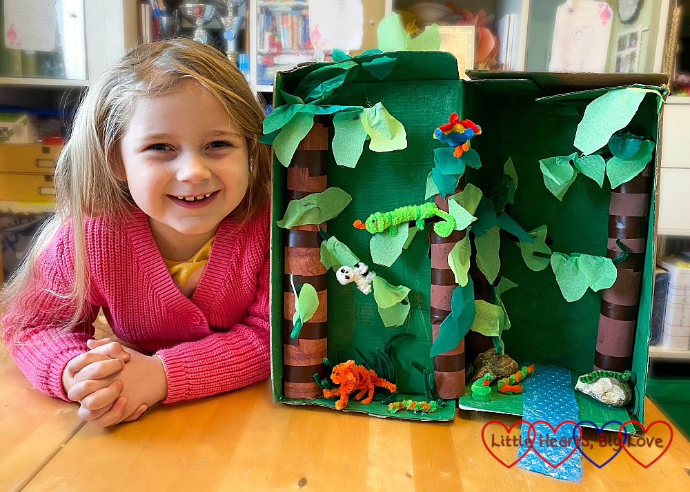 Sophie with her rainforest in a shoebox