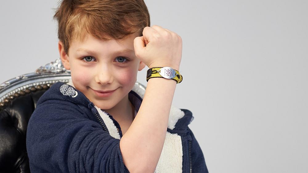 A boy wearing a MedicAlert bracelet