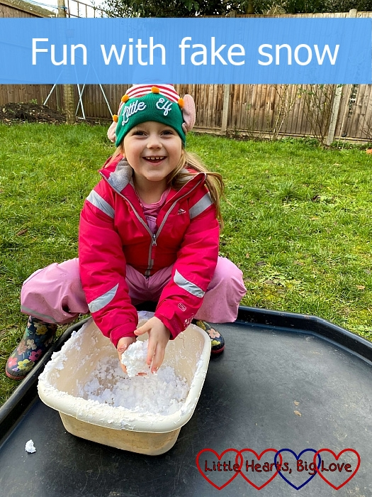"""Sophie playing with fake snow in a washing up bowl - """"Fun with fake snow"""""""