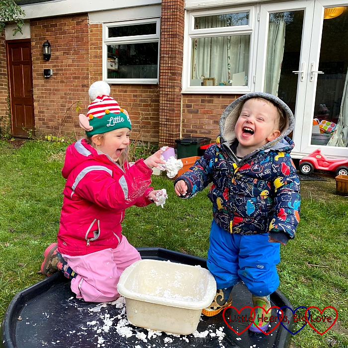 Sophie throwing a fake snow snowball at a laughing Thomas