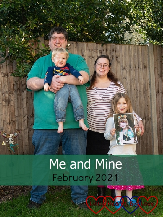 "My husband (holding Thomas), me and Sophie (holding Jessica's picture) out in the garden - ""Me and Mine - February 2021"""