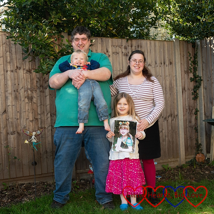 My husband (holding Thomas), me and Sophie (holding Jessica's picture) out in the garden