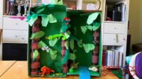 A rainforest in a shoebox with pipe cleaner animals