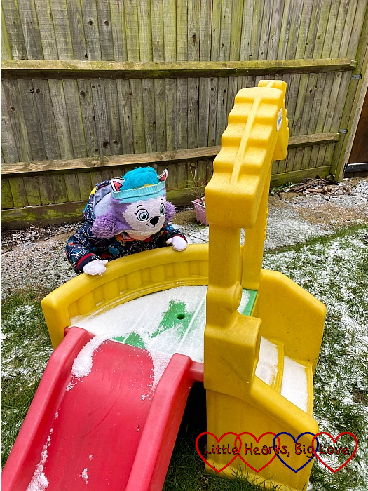 Thomas looking at the snow on the slide