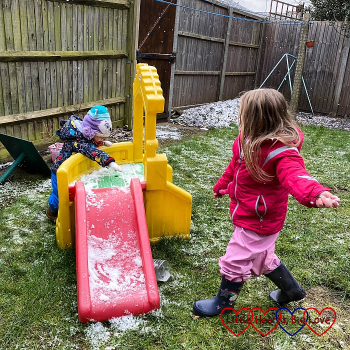 Sophie throwing snow at Thomas