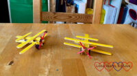 Two yellow clothes-peg planes