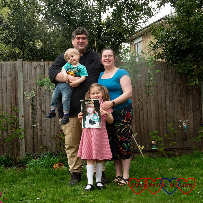Hubby (holding Thomas), me and Sophie (holding a photo of Jessica) out in the garden
