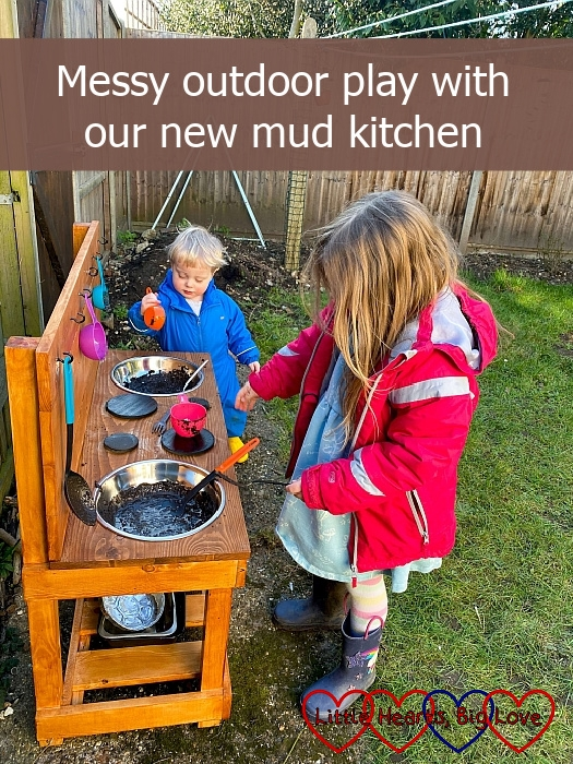 """Sophie and Thomas playing with mud in the bowls in their mud kitchen - """"Messy outdoor play with our new mud kitchen"""""""