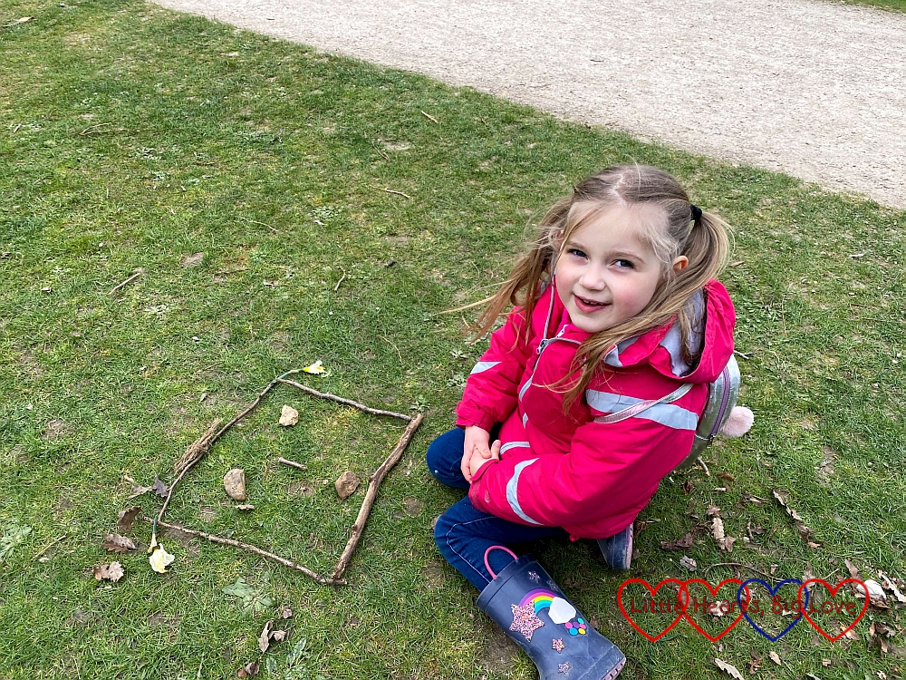 Sophie's face made out of sticks and stones