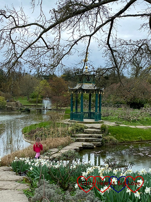 Sophie walking across the bridge to the pagoda in the water gardens at Cliveden