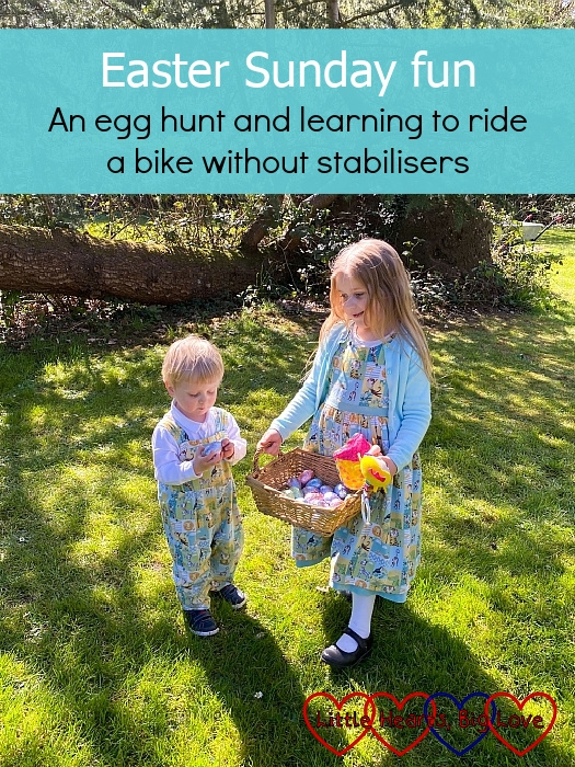 """Sophie and Thomas with a basket of Easter eggs in Grandma's garden - """"Easter Sunday fun: an egg hunt and learning to ride a bike without stabilisers"""""""