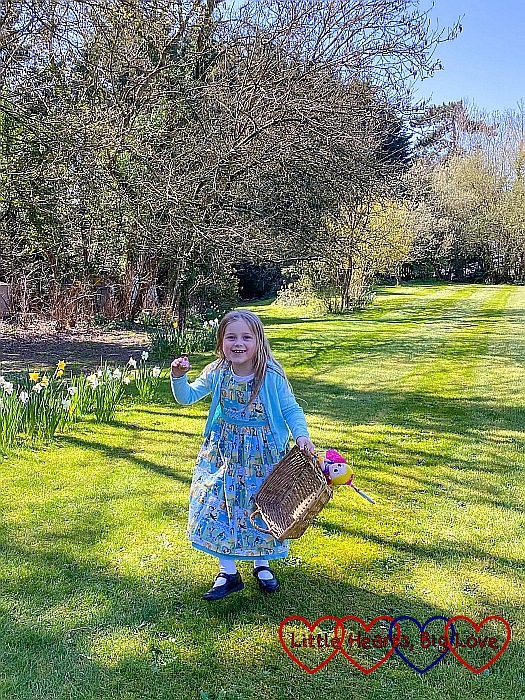 Sophie with a basket ready to do an Easter egg hunt in Grandma's garden