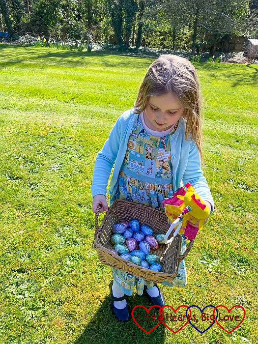 Sophie with a basket full of Easter eggs