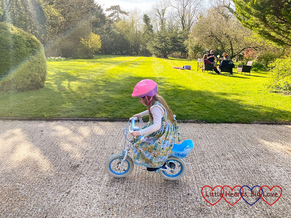 Sophie riding her bike without stabilisers on Grandma's driveway