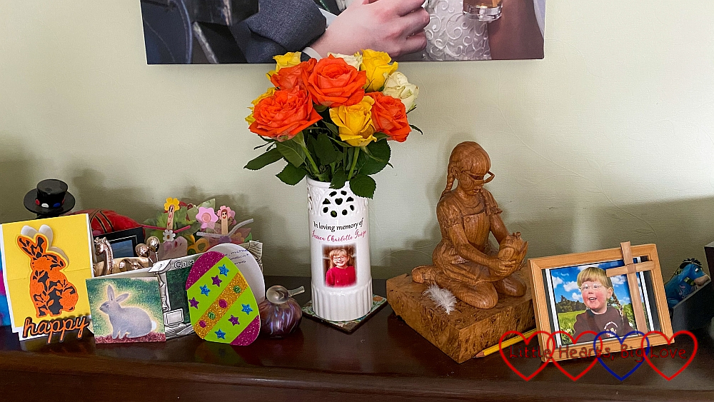 Easter cards, flowers in Jessica's vase, a wooden carving and a photo of Jessica on my piano