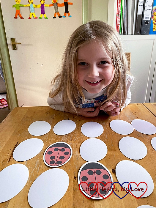 Sophie playing the ladybird matching game in the Springaling craft box