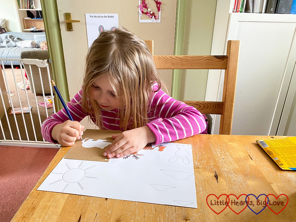 Sophie drawing a picture using the animal stencils from the Springaling craft box