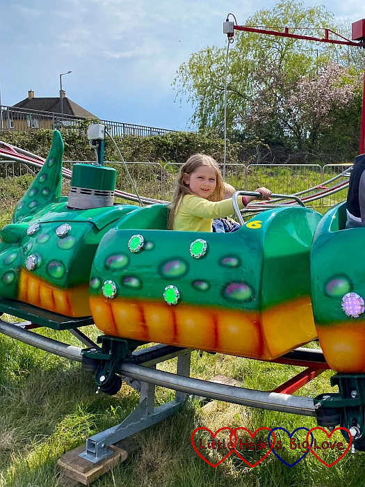 Sophie and Thomas on the mini 'Gator' rollercoaster ride