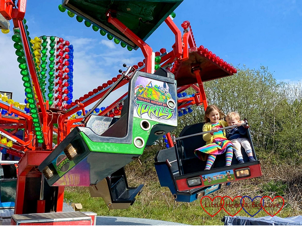 Sophie and Thomas on the mini paratrooper ride