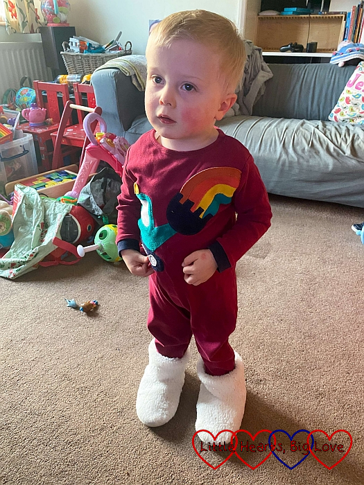Thomas wearing Sophie's slippers