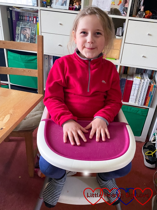 Sophie sitting in Thomas's high chair