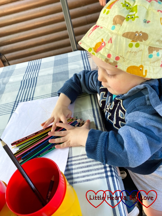 Thomas arranging the coloured pencils on the table