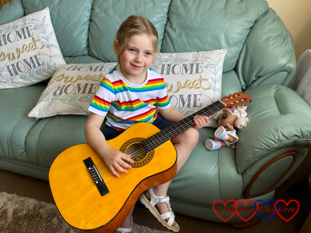 Sophie playing my mum's guitar