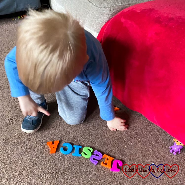 Thomas with his letters spelling out 'Jessica'