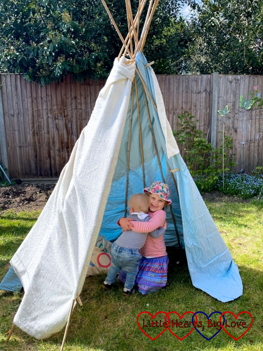 Thomas and Sophie in a tepee in the garden